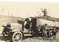 Historic photo - old truck towing logs